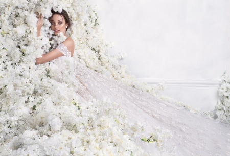 10004ae76 مصدر الصورة: Rami Al Ali. لطالما كانت فساتين الزفاف من تصاميم ...