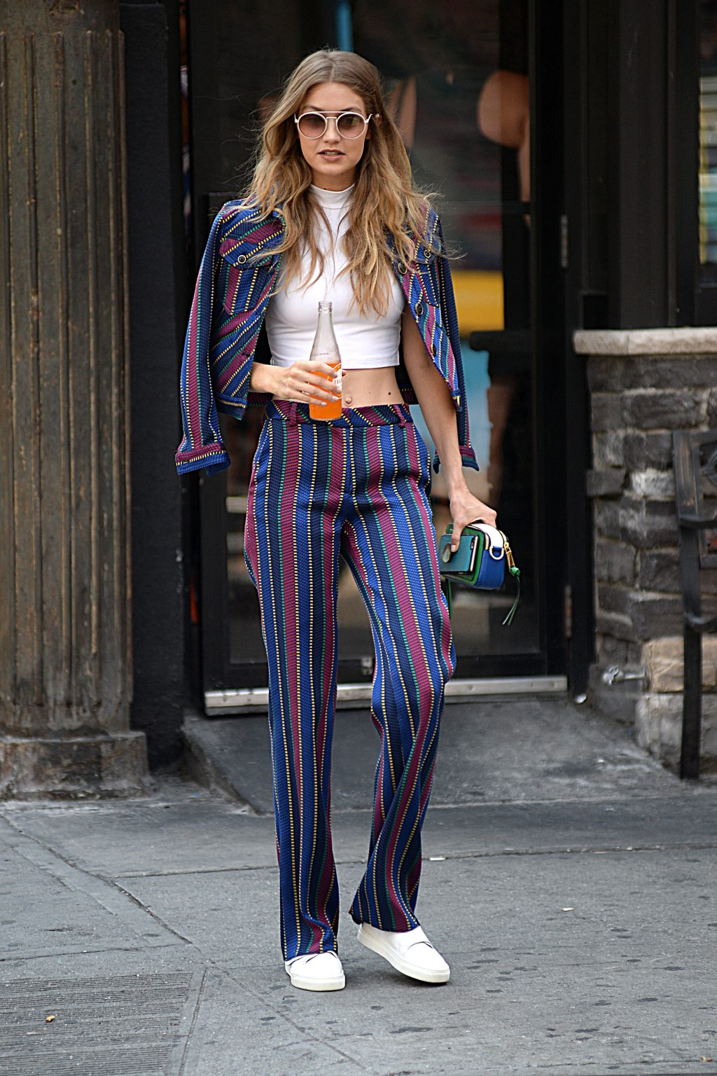 Gigi Hadid wears a 70's fashion inspired out fit stripes