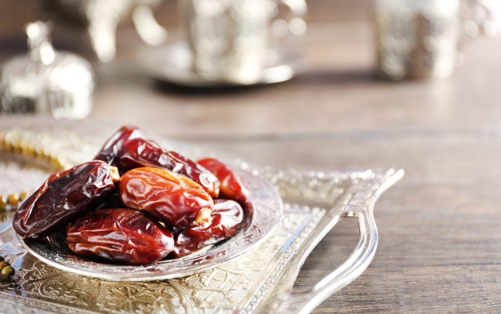 Dates fruit and rosary on beautiful tray