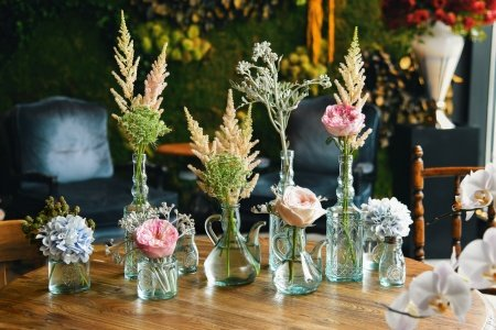 Forever-Rose-flowers-in-various-glass-bottles-jars